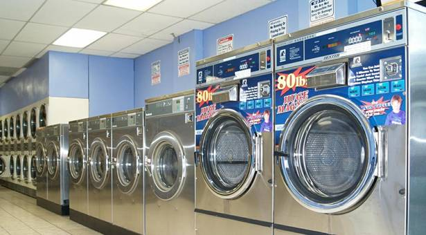 how much does a coin laundry machine cost